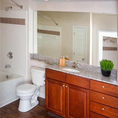 bathroom with wood-inspired flooring